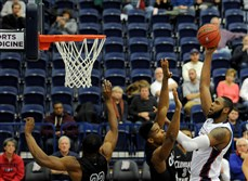 Darius Lewis takes a shot as Duquesne takes on Cleveland State at the A.J. Palumbo Center in Uptown on Sunday.