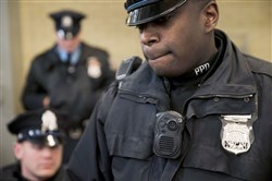 Philadelphia police officers demonstrate a body-worn camera used as part of a pilot project in Philadelphia. Government offices across Pennsylvania didn't apply the state's Right-to-Know Law uniformly, according to a May 2016 survey by 21 newspapers. Dash-cam videos have fueled a national debate on police policies and tactics, but in Pennsylvania those images remain largely out of sight, thanks to state laws that give law enforcement broad power to keep out of public view anything considered to be investigative material.