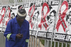 A man passes World AIDS Day banners in 2014 in Johannesburg. A new vaccine against HIV is to be tested in South Africa.
