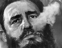 Fidel Castro exhales cigar smoke during an interview at the presidential palace in Havana, Cuba, in March 1985.