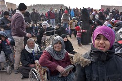 TOPSHOT - Syrian families, fleeing from various eastern districts of Aleppo, wait to board vehicles and head to government-controlled western Aleppo on November 29, 2016 in the government-held eastern neighbourhood of Jabal Badro, as the Syrian government offensive to recapture rebel-held Aleppo has prompted an exodus of civilians. The Syrian government offensive to recapture rebel-held Aleppo sparked international alarm, with the UN saying nearly 16,000 people had fled the assault and more could follow. The fighting has prompted an exodus of terrified civilians, many fleeing empty-handed into remaining rebel-held territory, or crossing into government-controlled western Aleppo or Kurdish districts.  / AFP PHOTO / GEORGE OURFALIANGEORGE OURFALIAN/AFP/Getty Images