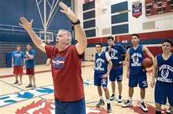Chartiers Valley coach Tim McConnell talks to his team at practice at the high school Tuesday in Collier. His team has the best record for boys basketball in the WPIAL since 2000.