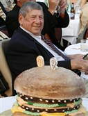 "Big Mac creator Michael ""Jim"" Delligatti sits behind a Big Mac birthday cake at his 90th birthday party in Canonsburg in 2008. Mr. Delligatti, of Fox Chapel, died Monday at the age of 98."