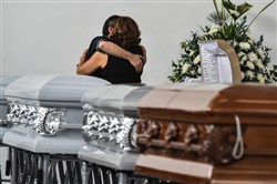Relatives of Nilson Junior Folle, a member of the Brazilian team Chapecoense Real soccer team killed when their charter plane crashed, embrace each other close to his coffin at Mortoury San Vicente in Medellin, Colombia, on Wednesday.