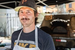 Neil Blazin, pictured, and Justin Vetter of Driftwood Oven will move into Matteo's space at 3615 Butler St. on Dec. 1.