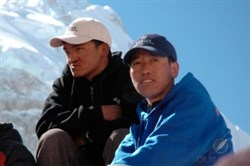 Ang Namgel Sherpa (left) and Lakpa Thundu Sherpa rest at Mt. Everest Base Camp in 2010. Monday morning, Thundu was killed in an avalanche triggered by an earthquake aftershock while climbing Mount Ama Dablam.