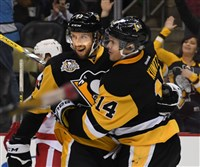 Penguins Nick Bonino celebrates his goal with Chris Kunitz against the Detroit Red Wings at PPG Paints Arena on Saturday.