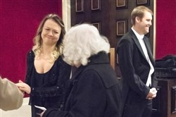 Cellists Bronwyn Banerdt, left, and Charlie Powers greet guests Friday before the Pittsburgh Symphony Orchestra's free concert at Heinz Hall.