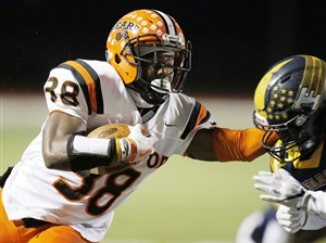 Clairton's Lamont Wade carries in a PIAA Class 1A semifinal against Farrell Friday at Slippery Rock University. Wade gained 248 yards in the victory for the Bears.