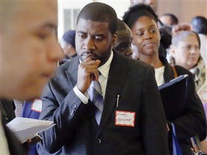 Job seekers attend a employment fair last month in New York City. Employers added 178,000 jobs in November, the government said, extending the longest streak of hiring since World War II.
