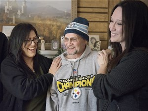 Jeffrey Cristina laughs with his nieces, Melanie Cristina, left, and Heather Taylor during a news conference at Taylor's home in Creighton on Saturday.