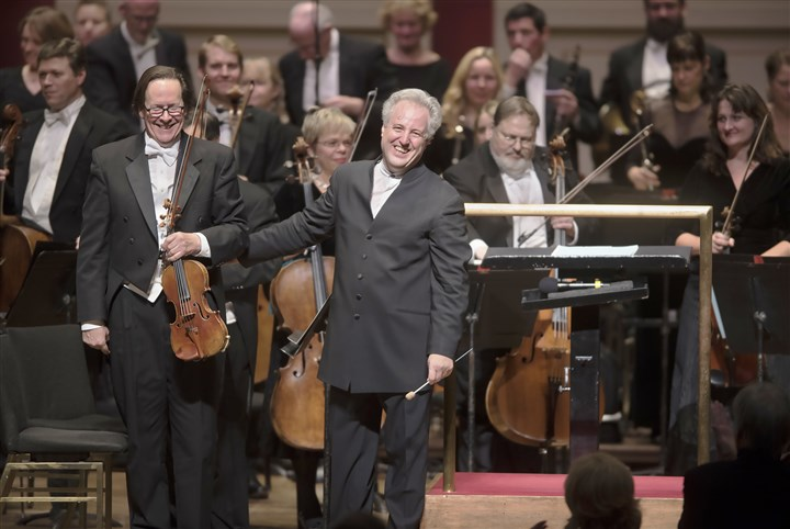 20161202hmnpso1203-13-26 Pittsburgh Symphony Orchestra and their music director, Manfred Honeck, stand for a standing ovation at the conclusion of their performance at The Music Has Returned! at Heinz Hall on Friday.