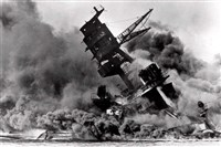 The USS Arizona sinks during the Japanese surprise attack on Pearl Harbor. The battleship, now the USS Arizona Memorial, remains the final resting place for 1,102 sailors and Marines.