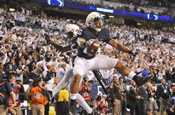Penn State running back Saquon Barkley celebrates after scoring against Wisconsin in the fourth quarter of the Big Ten Championship game at Lucas Oil Stadium in Indianapolis on Saturday.
