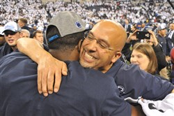 James Franklin celebrates with a player after winning the Big Ten championship Saturday in Indianapolis.