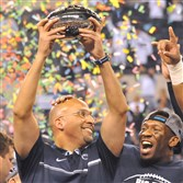 Coach James Franklin lifts the trophy after winning the Big Ten Championship Game at Lucas Oil Stadiumto meet USC in the Rose Bowl.