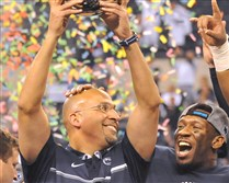 Penn State head coach James Franklin lifts the trophy after defeating Wisconsin in the Big Ten championship game. Penn State will face USC in the Rose Bowl on Jan. 2