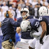 Penn State coach James Franklin celebrates with his players in the Big Ten Championship Saturday against Wisconsin in Indianapolis.