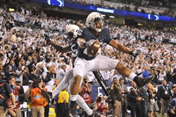 Penn State running back Saquon Barkley celebrates Saturday after scores the winning touchdown against Wisconsin in the fourth quarter of the Big Ten Championship Game at Lucas Oil Stadium in Indianapolis.