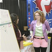 Juliann Guido, left, of the North hills talks with Michele Schwarz of Penn Hills as they waited for people to stop by their Geek Girl Brunch Pittsburgh booth at Wizard World Comic Con on Nov. 6.