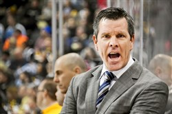 Penguins head coach Mike Sullivan shouts instructions during the Penguins game against the Detroit Red Wings.