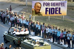 The motorcade carrying the ashes of the late Cuban leader Fidel Castro makes its final journey Sunday toward the Santa Ifigenia cemetery in Santiago, Cuba.