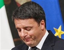 Italian Prime Minister Matteo Renzi speaks during a press conference in Rome, early Monday, where he conceded defeat in a constitutional referendum.