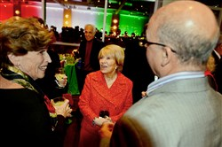 Event founder Carol Massaro, center, greets guests.