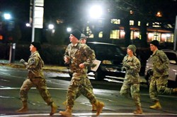 A squad of ROTC students runs across Forbes Avenue Monday morning, heading to Panther Hollow to collect 350 pounds of weight that represents part of an aircraft and return to the Cathedral of Learning. ROTC cadets from Pitt, Carnegie Mellon, Chatham, Carlow, Duquesne and Point Park participated.