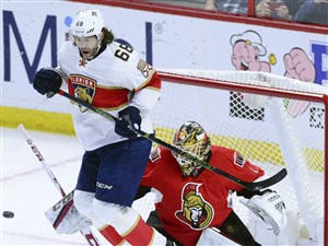 The Panthers' Jaromir Jagr jumps out of the way of a shot on Ottawa goaltender Mike Condon Saturday in Ottawa.