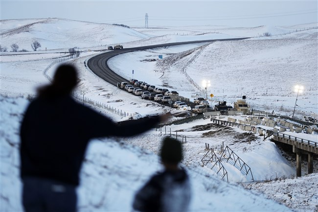 Law enforcement vehicles line a road leading to a blocked bridge next to the Oceti Sakowin camp, where people have gathered to protest the Dakota Access oil pipeline in Cannon Ball, N.D., on Saturday.