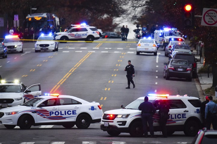Gunman Pizza Shop-2 Police secure the scene near Comet Ping Pong in Washington, D.C., on Sunday.