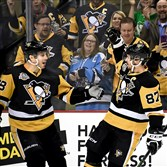 Sidney Crosby celebrates with Ian Cole on Monday.