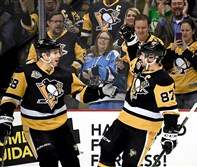 Sidney Crosby celebrates his first period goal with Ian Cole against the Senators at PPG Paints Arena.