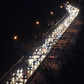 A ribbon of headlights make their way inbound toward the Squirrel Hill Tunnels on the Parkway East.