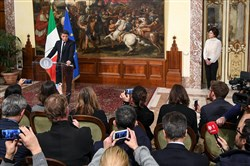 Italian Premier Matteo Renzi, left, speaks during a press conference Monday at the premier's office Chigi Palace in Rome.
