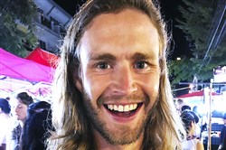This photo taken Oct. 19 in Thailand, shows Nick Walrath in the Chiang Mai Night Market. Mr. Walrath was listed as missing Monday in a deadly warehouse fire in Oakland, Calif.