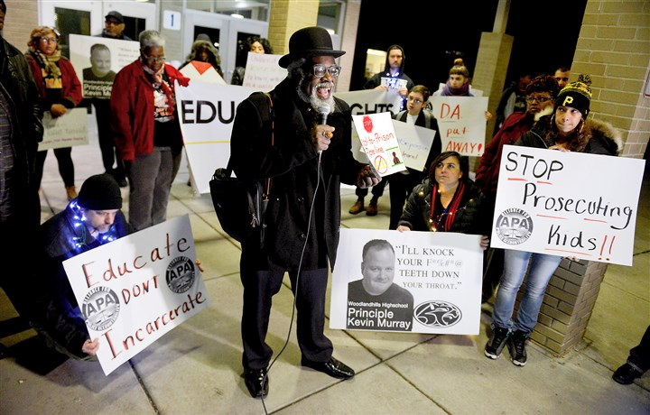 20161205MWHprotestLocal06-5 Paradise Gray of One Hood speaks as protesters call for the firing of Woodland Hills Junior/Senior High School principal Kevin Murray. They gathered outside a school board meeting Monday.