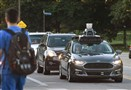 An Uber self-driving Ford Fusion sits at a traffic light on Beechwood Boulevard and waits to turn onto Fifth Avenue.