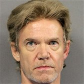 Ronald Gasser, seen in a Jefferson Parish, La., Sheriff's Office booking photo, has been arrested in the fatal shooting of ex-NFL player Joe McKnight during a road rage dispute in a New Orleans suburb.