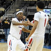 Robert Morris' Dachon Burke (11) and Isaiah Still