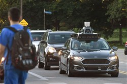 A self-driving Uber sits at a red light on Beechwood Boulevard in Squirrel Hill.