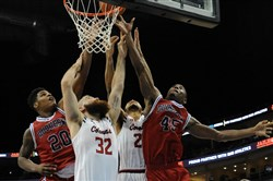 Roberto Mantovani, second from left, and others battle for a rebound during the Robert Morris-Duquesne game at PPG Paints Arena in December.