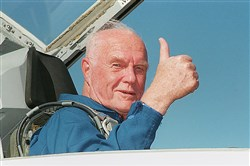 John Glenn became the oldest person to fly in space on his second flight aboard space shuttle Discovery.