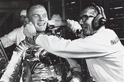 Guenter Wendt, the original pad leader for NASA's manned space program, coaxes a smile out of astronaut John Glenn after the MA-6 mission was scrubbed.