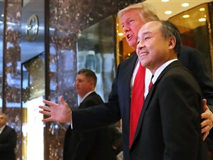 President-elect Donald Trump pauses with Masayoshi Son, the chief executive of SoftBank, at Trump Tower on Tuesday in New York City.