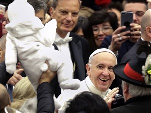 Pope Francis arrives for his weekly general audience, in the Pope Paul VI hall, at the Vatican, Wednesday.
