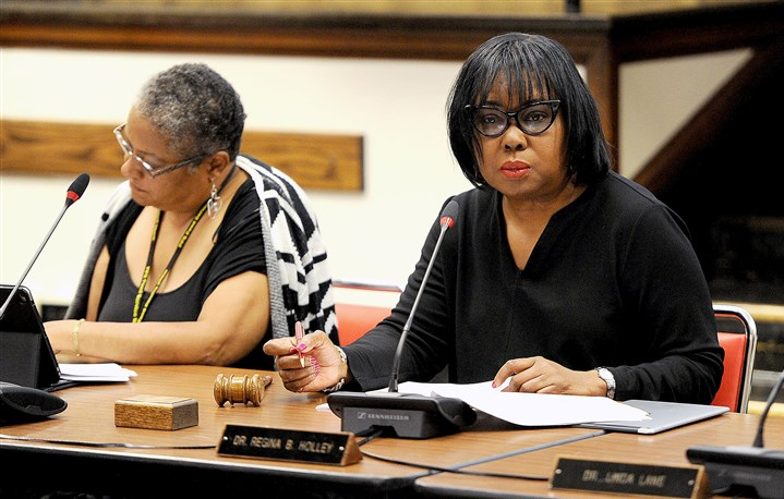 20160615MWHschoolboardLocal01 Dr. Regina Holley listens to the agenda during a Pittsburgh school board meeting in Oakland.