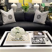 A Tobi Fairley coffee table is paired with her Eva sofa for C.R. Laine in Derek Onyx fabric.