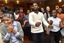 "Pirates center fielder Andrew McCutchen shows off his dance moves during a Pirates charities winter ""Care-A-Van"" at Zone 28 Thursday in Harmar."